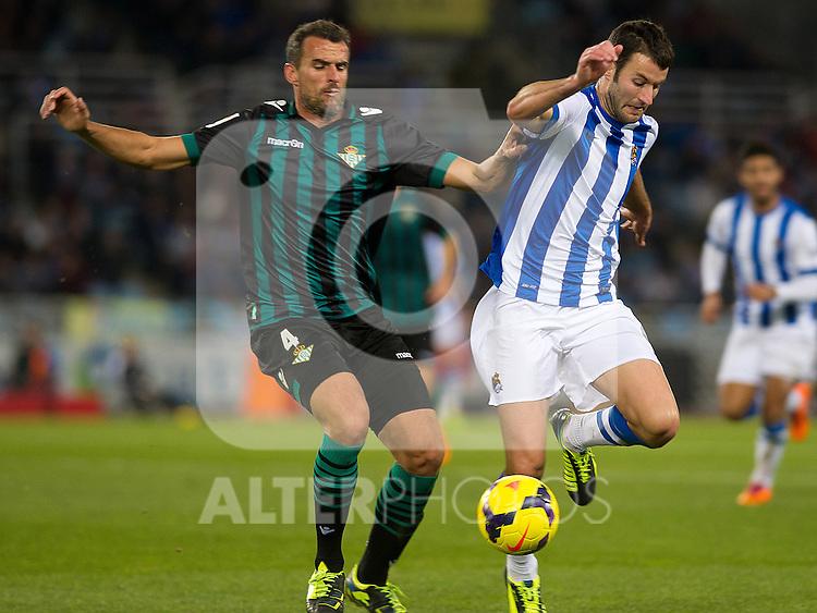 Real Sociedad's Imanol Agirretxe (r) and Betis' Antonio Amaya during La Liga match.November 23,2013. (ALTERPHOTOS/Mikel)