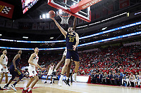 RALEIGH, NC - JANUARY 9: John Mooney #33 of the University of Notre Dame shoots a layup during a game between Notre Dame and NC State at PNC Arena on January 9, 2020 in Raleigh, North Carolina.