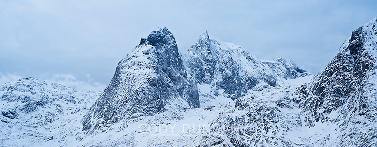 Snow covered mountain peaks in winter, Moskenesoy, Lofoten Islands, Norway