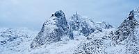 Snow covered mountain peaks in winter, Moskenesoy, Lofoten Islands, Norway