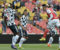 BOGOTÁ -COLOMBIA, 22-03-2014. Wilder Medina (Der.) jugador de Independiente Santa Fe disputa el balón con Johnny Mostacilla (Izq.) jugador de Boyaca Chico FC, durante partido por la fecha 12 de la Liga Postobon I-2014, jugado en el estadio Nemesio Camacho El Campin de la ciudad de Bogota. / Wilder Medina (R) jugador of Independiente Santa Fe vies for the ball with Johnny Mostacilla (L) player of Boyaca Chico FC during a match for the 12th date of the Liga Postobon I-2014 at the Nemesio Camacho El Campin Stadium in Bogota city. Photo: VizzorImage/ Gabriel Aponte / Staff