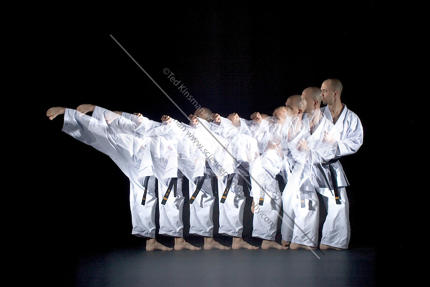 A black belt karate expert performs a kick. A special stroboscopic camera records the motion.  The record of the motion can be analyzed to show both the timing and range of the motion.  This type of image is very important in the science of biomechanics.
