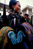 Black H'mong woman with indigo stained hands, Sapa, Vietnam