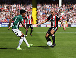 Rico Henry of Brentford in action with Samir Carruthers of Sheffield Utd during the English championship league match at Bramall Lane Stadium, Sheffield. Picture date 5th August 2017. Picture credit should read: Jamie Tyerman/Sportimage
