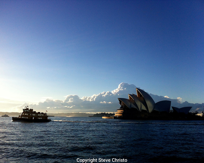 A morning ferry from Circular Quay across in front of the Sydney Opera House and makes her way to the Harbour Bridge.  Sydney Australia. Thursday May 3rd 2012 .(Photo Steve Christo).