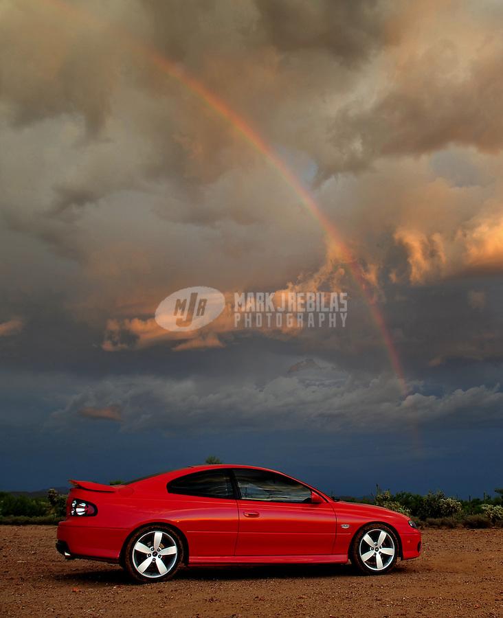 2005 Pontiac GTO red sportscar car automotive photography desert Arizona Holden mountains rainbow sunset
