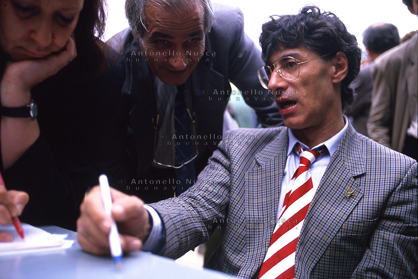 April 1994, Pontida Italy. Umberto Bossi, former minister in Berlusconi's cabinet, and founder of the right-wing, xenophobic Italian party Lega Nord, just resigned from his office as party secretary. This happens as consequence of a series of scandals linked to Bossi and other major figures of Lega Nord..Umberto Bossi during the national rally of Lega Nord in Pontida.
