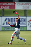 Hagerstown Suns shortstop Osvaldo Abreu (10) chases down a flt ball in shallow left field during the game against the Kannapolis Intimidators at CMC-Northeast Stadium on July 19, 2015 in Kannapolis, North Carolina.  The Suns defeated the Intimidators 9-4.  (Brian Westerholt/Four Seam Images)