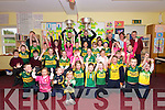 Scoil an Ghleanna pupils and teachers welcoming Kerry players Marc Ó Sé and Brian Rael (minors) bringing Sam Maguire and Tom Markham cups to the school on Wednesday.
