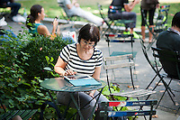 A reader uses her iPad in Bryant Park in New York on Tuesday, August 21, 2012 (© Richard B. Levine)