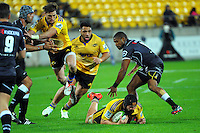 Blade Thomson goes to ground with Cory Jane and Motu Matu'u in support during the Super Rugby match between the Hurricanes and Sharks at Westpac Stadium, Wellington, New Zealand on Saturday, 9 May 2015. Photo: Dave Lintott / lintottphoto.co.nz