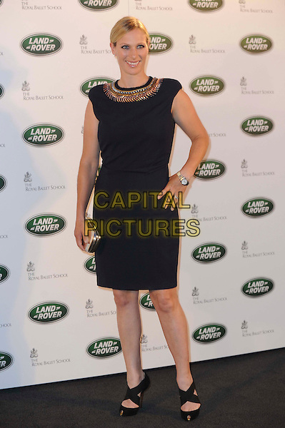 Zara Phillips.The All New Range Rover launch at the Royal Ballet School in Richmond Park, London, England..6th September 2012.full length hand on hip gold clutch bag silver collar black dress .CAP/CAS.©Bob Cass/Capital Pictures.
