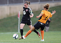BOYDS, MARYLAND-JULY 07,2012:  Mikaela Howell (8) of DC United Women moves past Claire Falknor (6) of Dayton Dutch Lions during a W League game at Maryland Soccerplex, in Boyds, Maryland. DC United women won 4-1.