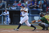 Asheville Tourists second baseman Michael Benjamin #18 swings at a pitch during a game against the Savannah Sand Gnats at McCormick Field July 16, 2014 in Asheville, North Carolina. The Tourists defeated the Sand Gnats 6-3. (Tony Farlow/Four Seam Images)