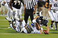 1 October 2011:  FIU quarterback Wesley Carroll (13) dives over Duke safety Walt Canty (4) in a effort to recover his fumble in the second quarter as the Duke University Blue Devils defeated the FIU Golden Panthers, 31-27, at FIU Stadium in Miami, Florida.