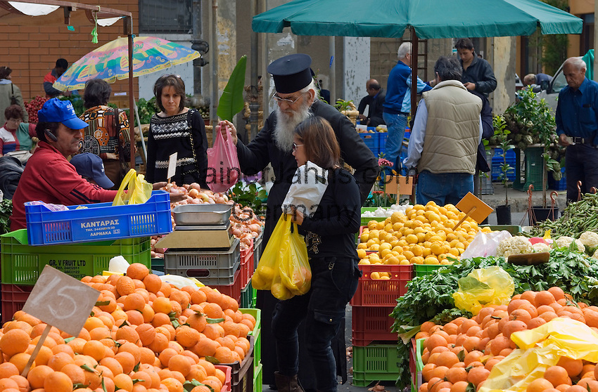 CYPRUS, capital Nicosia (Lefkosia): market, priest shopping<br />