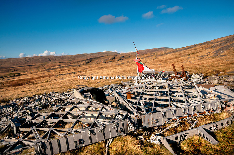 """Pictured: The wreckage of the Wellington Bomber MF509 in the Brecon Beacons, Wales, UK. <br /> Re: The nephew of a World War II airman whose plane crashed into a Welsh mountain has climbed the peak to pay tribute to the uncle he never met.<br /> Dr Peter Paré, 74, travelled from his home in Vancouver, Canada, to read a poem at the desolate spot where his uncle Bill Allison was killed.<br /> Flying officer Allison, 28, was one of the six crew of a Wellington Bomber that crashed on a training flight in November 1944.<br /> The plane wreckage is still scattered over Carreg Goch in the Brecon Beacons where hundreds of young airmen learned to prepare for bombing missions.<br /> Dr Paré said: """"I wanted to make this pilgrimage even though I was a baby when he died and never met Bill Allison.<br /> """"We only found out about the crash site recently and it is remarkable that so much of the plane is still here.""""<br /> Flying officer Allison was the oldest on board when the plane's starboard engine developed a fault during a low-flying exercise.<br /> For years local people have honoured the brave airmen by flying a Canadian flag at the scene - replacing it every time it gets ripped by strong winds.<br /> Dr Paré, retired Professor of Medicine at the University of British Columbia, said: """"It was very moving to see the Maple Leaf flying where my uncle died all those years ago.<br /> """"It brought a tear to my eye as I read the poem I wrote in his honour."""""""