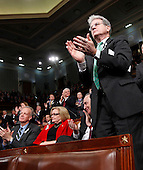 United States Senator Tom Coburn, R-Okla., right, accompanied Sen. Charles Schumer, D-N.Y., second from right, and Sen. Clair McCaskill, D-Mo., applauds on Capitol Hill in Washington, Tuesday, Jan. 25, 2011, during President Barack Obama's State of the Union address.  .Credit: Pablo Martinez Monsivais / Pool via CNP