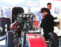 Feb 8, 2015; Pomona, CA, USA; Crew members working in the pit of NHRA funny car driver Cruz Pedregon during the Winternationals at Auto Club Raceway at Pomona. Mandatory Credit: Mark J. Rebilas-