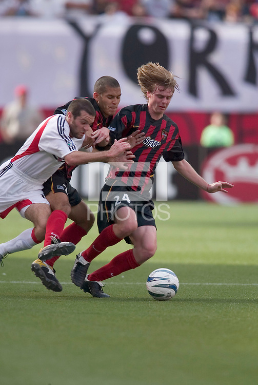 The MetroStars' Eddie Gaven and Craig Ziadie try to keep D.C. United's Ben Olsen away from the ball. D. C. United was defeated by the NY/NJ MetroStars 3 to 2 during the MetroStars home opener at Giant's Stadium, East Rutherford, NJ, on April 17, 2004.