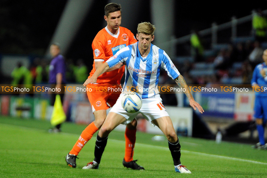 Jonathan Stead of Huddersfield Town holds up the ball from Chris Basham of Blackpool - Huddersfield Town vs Blackpool - Sky Bet Championship Football at the John Smiths Stadium, Huddersfield, West Yorkshire - 27/09/13 - MANDATORY CREDIT: Greig Bertram/TGSPHOTO - Self billing applies where appropriate - 0845 094 6026 - contact@tgsphoto.co.uk - NO UNPAID USE