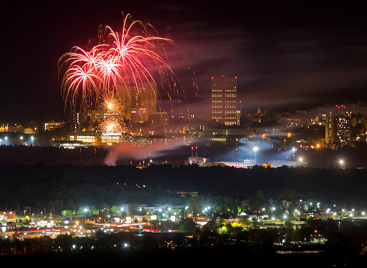 Fireworks are seen from the top of Mount Holyoke as they burst over the University of Massachusetts at Amherst campus during Homecoming weekend festivities on Friday, September 26, 2014. Photo by Christopher Evans