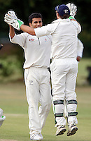 Wembleys' Sneh Shah (L) is congratulated after dismissing Patrick Mills of North London during the Middlesex County League Division Three game between North London and Wembley at Park Road, Crouch End on Sat July 24, 2010