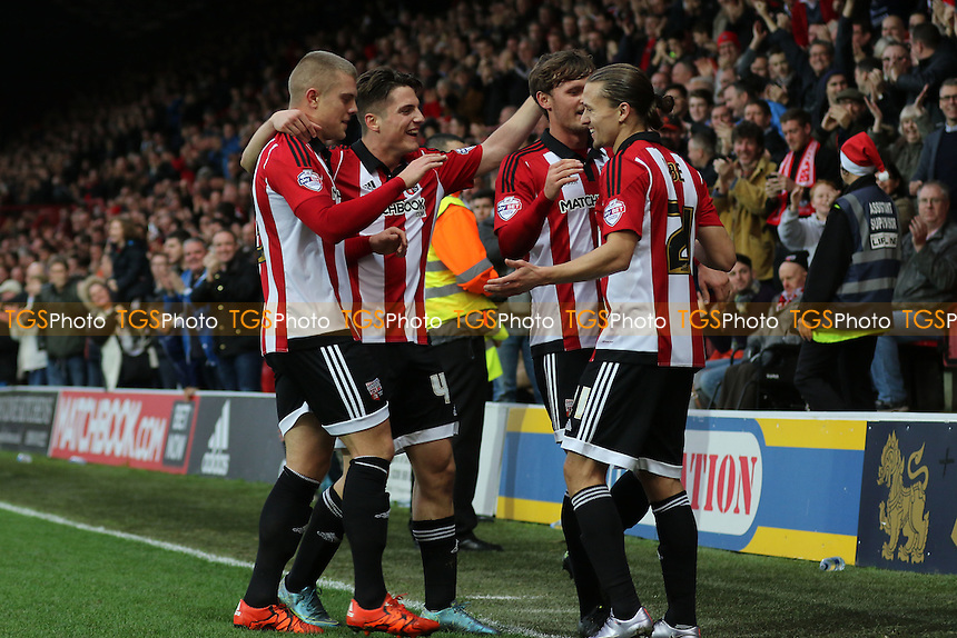 Brentford players congratulate Lasse Vibe(right) after scoring their second goal during Brentford vs Huddersfield Town, Sky Bet Championship Football at Griffin Park, London, England on 19/12/2015