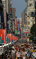 Saturday shoppers pack Shanghai's famous shopping street, Nanjing Lu.  The street attracts hundreds of thousands of consumers and is home to many of the world's largest brand names..25 Sept 05
