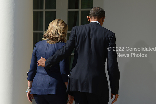 United States President Barack Obama (R) walks out of the Rose Garden with US Secretary of State Hillary Clinton (L) after delivering remarks on the killing of US ambassador to Libya, Christopher Stevens, and three embassy staff, at the White House in Washington DC, USA, 12 September 2012. Gunmen attacked the US consulate in Benghazi, killing Stevens and three others, late 11 September 2012, while another assault took place on the US embassy in Cairo..Credit: Michael Reynolds / Pool via CNP