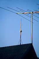 LIGHTNING ROD<br /> Florida, NY<br /> Lightning rod on wooden roof next to television antenna. Lightning rods form a low-resistance path for the lightning  discharge and prevent it from traveling through the structure