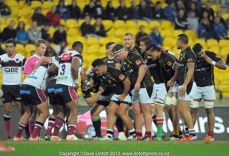The Lions scrum packs down during the ITM Cup rugby union match between Wellington Lions and North Harbour at Westpac Stadium, Wellington, New Zealand on Saturday, 28 August 2013. Photo: Dave Lintott / lintottphoto.co.nz