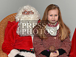 Saoirse Carron with Santa at the Dunleer Christmas Fair in the Market House. Photo:Colin Bell/pressphotos.ie