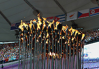 August 05, 2012: Olympic Cauldron designed by Thomas Heatherwick which consists 204 copper petals each representing a competing nation, burns at the Olympic Stadium on day nine of 2012 Olympic Games in London, United Kingdom.