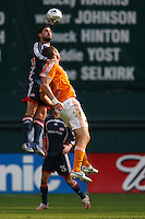 New England Revolution defender (6) Jay Heaps out jumps Houston Dynamo forward (21) Nate Jaqua for a head ball. The Houston Dynamo defeated the New England Revolution 2-1 in the finals of the MLS Cup at RFK Memorial Stadium in Washington, D. C., on November 18, 2007.