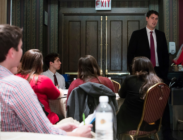 Brian Howe, event marketing manager for the Chicago Blackhawks NHL hockey team, speaks to DePaul University Driehaus College of Business students about his role in the organization during their class Behind the Scenes with Chicago Sports Organizations Tuesday, Dec. 1, 2015 at the United Center. Throughout the week-long course, students participated in behind the scenes tours of sports organizations and venues to gain first hand insights into the sports business landscape of Chicago. (DePaul University/Jeff Carrion)