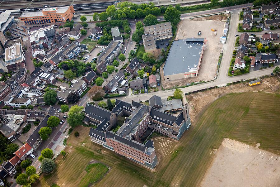 Nederland, Limburg, Gemeente Sittard-Geleen, 27-05-2013; centrum van Sittard met braakliggend terrein van gesloopte Maaslandziekenhuis,  kloostergebouw en de voormalige ziekenhuiskapel van de Goddelijke Voorzienigheid.<br /> Town centre Sittard with vacant lot. <br /> luchtfoto (toeslag op standaardtarieven);<br /> aerial photo (additional fee required);<br /> copyright foto/photo Siebe Swart.