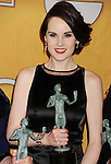 LOS ANGELES, CA - JANUARY 27: Michelle Dockery poses at the 19th Annual Screen Actors Guild Awards at The Shrine Auditorium on January 27, 2013 in Los Angeles, California.