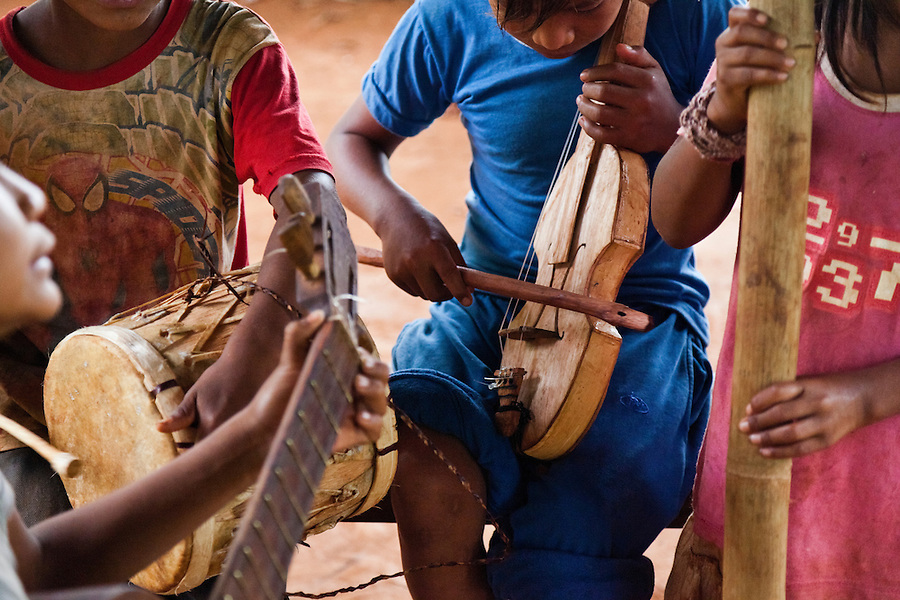 Children of Mbya Guarani village Andresito playing traditional music.  San Ignacio, Misiones, Argentina.