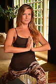Young woman doing yoga inside her hime