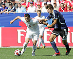 12 July 2007: Poland's Dawid Janczyk (11) dribbles through the hold of Argentina's Frederico Fazio (2). Argentina's Under-20 Men's National Team defeated Poland's Under-20 Men's National Team 3-1 in a  round of 16 match at the National Soccer Stadium (also known as BMO Field) in Toronto, Ontario, Canada during the FIFA U-20 World Cup Canada 2007 tournament.