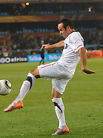 Landon Donovan celebrates the match's final whistle by kicking the match ball into the U.S. crowd. The United States won Group C of the 2010 FIFA World Cup in dramatic fashion, 1-0, over Algeria in Pretoria's Loftus Versfeld Stadium, Wednesday, June 23rd..