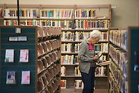 NWA Democrat-Gazette/J.T. WAMPLER Mitzi Bardrick of Rogers looks for books Monday Sept. 14, 2015 at the Rogers Public Library. The monthly board meeting of the Friends of the Library is today ((TUESDAY SEPT 15)) in the Glotzbecker Conference Room at the library.