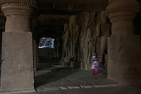 Ellora Caves Aurangabad in India..The famous Ellora caves are located in the lap of the Chamadari hills. These historical caves are regarded as world heritage and are situated 18 miles northwest of Aurangabad.  .A wonderful example of cave temple architecture, the world heritage Ellora caves own elaborate facades and intricately carved interiors. These carved structures on the inner walls of the caves reflect the three faiths of Hinduism, Buddhism and Jainism. These exotic caves were carved during 350 AD to 700 AD period. .Ellora caves are hewn out of basaltic rock of the Deccan trap, and are datable from circa 5th century A.D. to 11th century A.D. In all 34 caves were excavated here out of which Cave 1 to 12 are Buddhist, 13 to 29 are Brahmanical and 30 to 34 are Jaina.