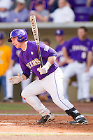 Tyler Hanover #11 of the LSU Tigers follows through on his swing against the Wake Forest Demon Deacons at Alex Box Stadium on February 20, 2011 in Baton Rouge, Louisiana.  The Tigers defeated the Demon Deacons 9-1.  Photo by Brian Westerholt / Four Seam Images