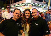 Oct. 26, 2012; Las Vegas, NV, USA: NHRA top fuel dragster driver Steve Torrence (left) and Brandon Bernstein (right) with a fan during qualifying for the Big O Tires Nationals at The Strip in Las Vegas. Mandatory Credit: Mark J. Rebilas-