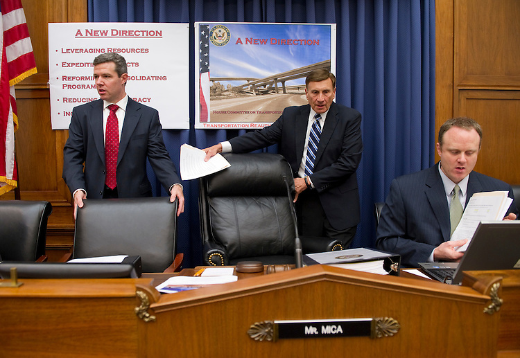WASHINGTON, DC - July 07: Flanked by aides, House Transportation Chairman John L. Mica, R-Fla., takes his seat for a news conference in the committee hearing room introducing the Republican transportation reauthorization proposal. (Photo by Scott J. Ferrell/Congressional Quarterly)