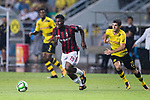 AC Milan Midfielder Franck Kessie (L) dribbles Borussia Dortmund Midfielder Christian Pulisic (R) during the International Champions Cup 2017 match between AC Milan vs Borussia Dortmund at University Town Sports Centre Stadium on July 18, 2017 in Guangzhou, China. Photo by Marcio Rodrigo Machado / Power Sport Images