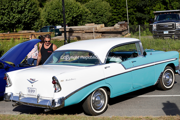Naugatuck, CT- 13 August 2017-081317CM06-   Mike St. John of Naugatuck checks out a Chevy Bel Air in downtown Naugatuck on Sunday. The town held a summer festival and car show.  The event featured food, crafts, vendors, games, and inflatable obstacle courses.  The night ended with a fireworks display.    Christopher Massa Republican-American
