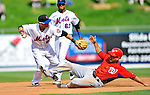 28 February 2011: New York Mets infielder Chin-lung Hu doubles off Danny Espinosa during a Spring Training game against the Washington Nationals at Digital Domain Park in Port St. Lucie, Florida. The Nationals defeated the Mets 9-3 in Grapefruit League action. Mandatory Credit: Ed Wolfstein Photo